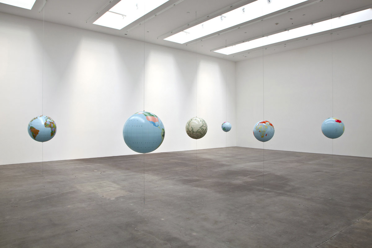 Sam Durant – Financial Secrecy Index (Top Ten Places for Tax Evasion and Money Laundering); Fortune 500 (2010); The World in 2011: GDP and Total Corporate Assets; Pigs and Gold; Top Ten: Art and Prisons; Antipodean Globe (Desliens 1566), 2011 Custom Globes (acrylic, paper), steel cable, miscellaneous hardware Dimensions vary